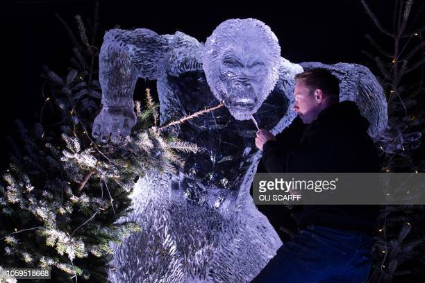 TOPSHOT Ice sculptor Mark Hackney puts the finishing touches to a yeti carved from ice in the 'Ice Village' during a photocall to promote the 'Ice...