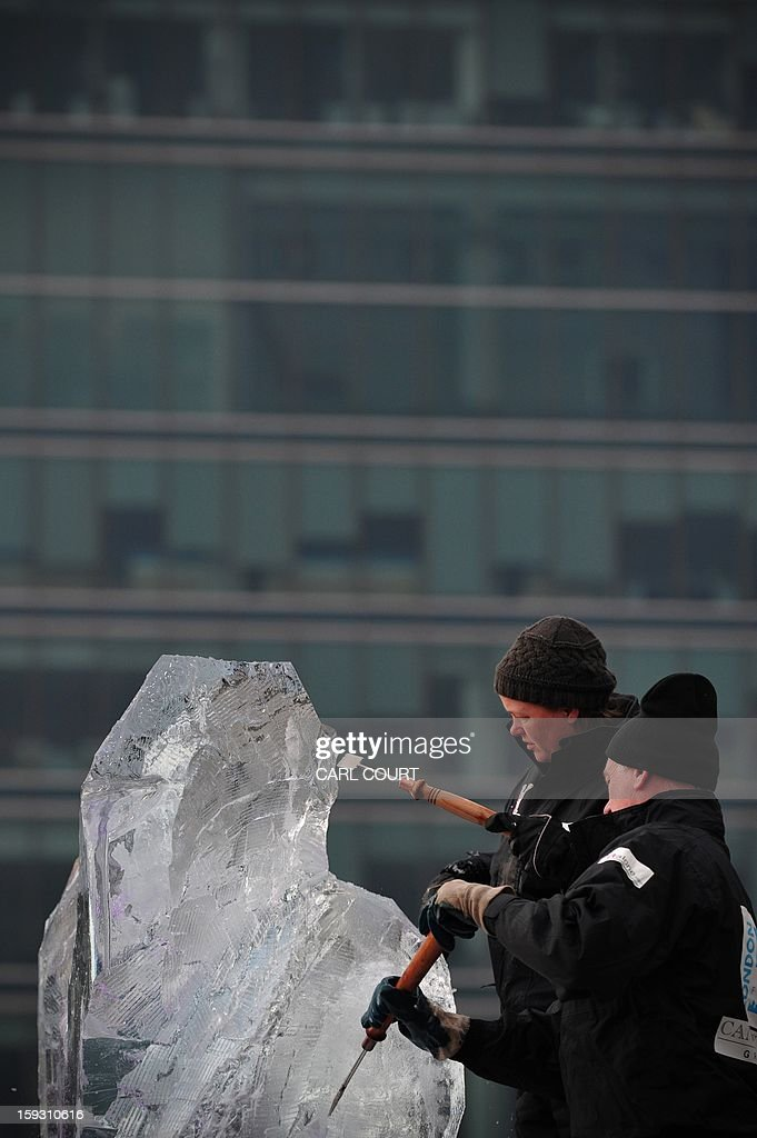 Ice sculptors works on a block of ice during the London Ice Sculpting Festival in Canary Wharf, east London, on January 11, 2012. Competitors from Britain, the US, France, Hungary, Bulgaria, Spain, Sweden, Netherlands, Latvia, Belgium and Portugal are competing in the festival which runs from January 11-13, 2013.