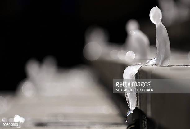 Ice sculpture entitled 'Minimum Monument' by Brazilian artist Nele Azevedo melts on the steps of Berlin's Concert Hall at the Gendarmenmarkt on...