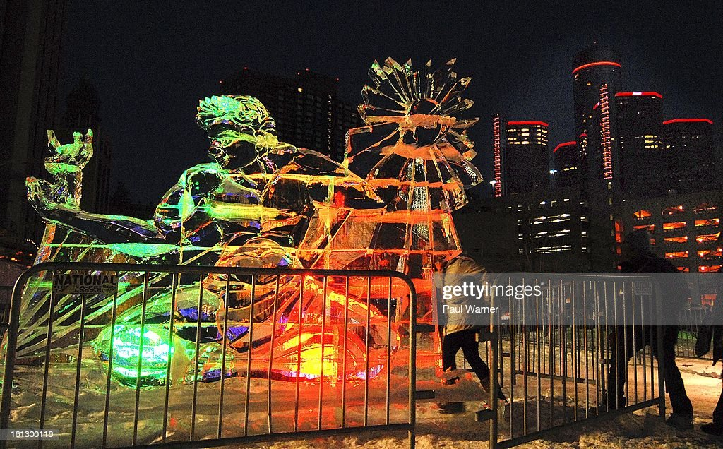 A ice sculpture of the Spirit of Detroit statue sits under the lights of the General Motors building at Motown Winter Blast at Campus Martius Park on February 9, 2013 in Detroit, Michigan.