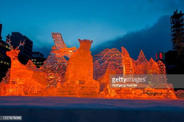Ice sculptures illuminated at night at the Sapporo Snow Festival in Sapporo, Hokkaido Island, Japan.
