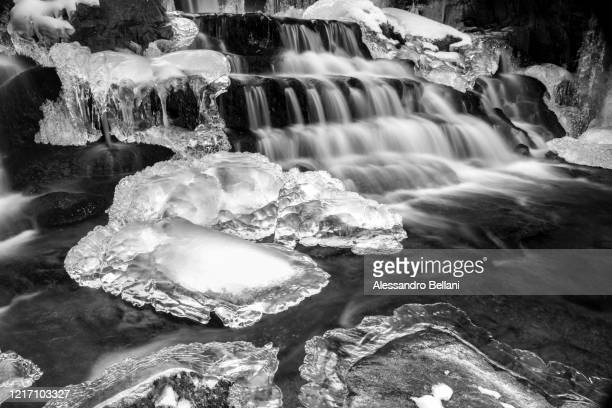 ice sculptures in the creek, italy, europe - ice floe stock pictures, royalty-free photos & images
