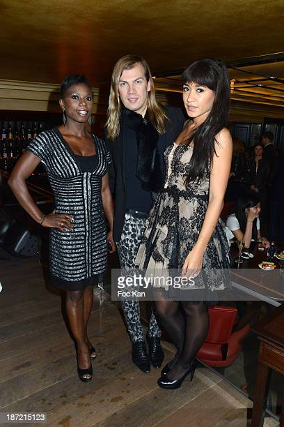 Ice skater champion Surya Bonaly Christophe Guillarme and Josephine Jobert attend the 'Bistro Chic Napoleone' Champs Elysees Opening Cocktail on...