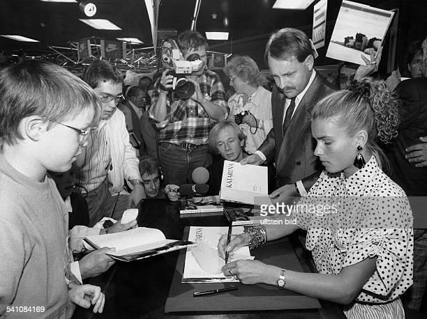 GDR ice skater Katharina Witt signing in the department store KaDeWe WestBerlin September 1988