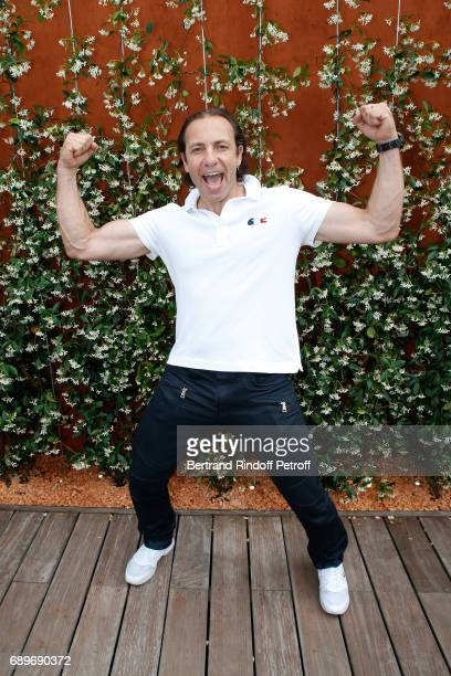 Ice skater Philippe Candeloro dressed in Lacoste attends the 2017 French Tennis Open Day Two at Roland Garros on May 29 2017 in Paris France