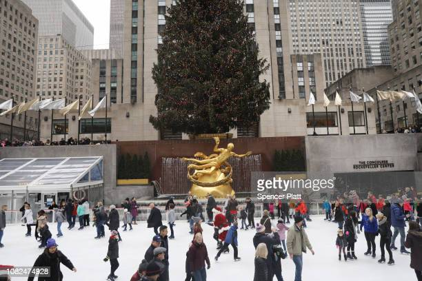Ice skaters are joined by a man dressed as Santa Claus at The Rink at Rockefeller Center on December 14, 2018 in New York City. Rockefeller Center,...