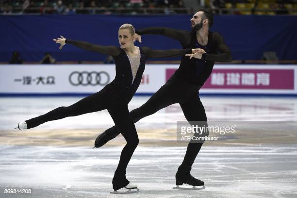 US' ice skaters Ashley Cain and Timothy Leduc perform in Pairs Short Program during the Cup of China ISU Grand Prix of Figure Skating in Beijing on...