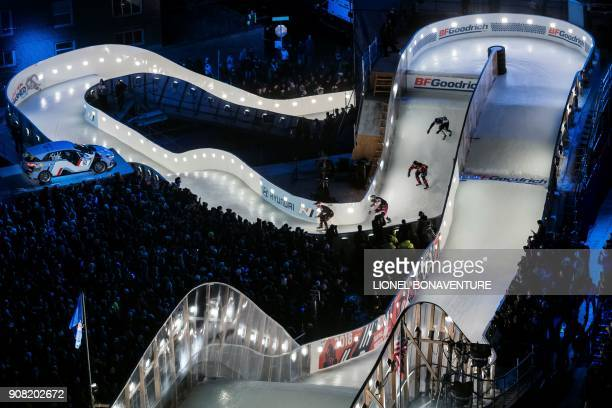 TOPSHOT Ice skaters compete during the 'Redbull Crashed Ice' the Ice Cross Downhill World Championship in Saint Paul on January 20 2018 / AFP PHOTO /...