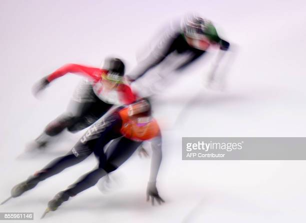 Ice skaters compete during the semifinal of the Women's 3000m relay race the ISU Short Track Speed Skating World Cup at the BOK Hall in Budapest on...