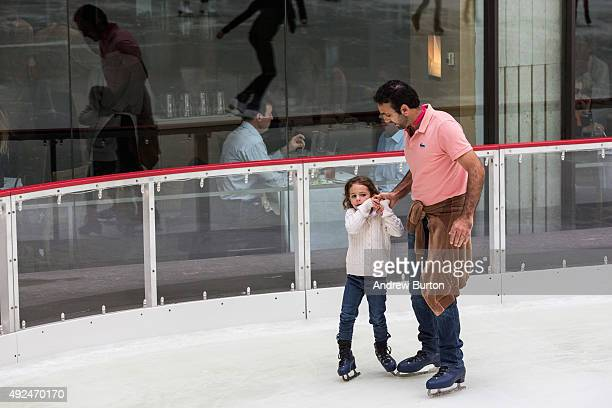 Ice skaters enjoy the Rockefeller Center Ice Rink on its opening day on October 13 2015 in New York City The rink will be open from 830AM until...