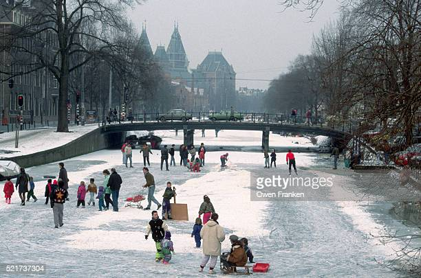 Ice Skaters on Frozen Canal in Amsterdam