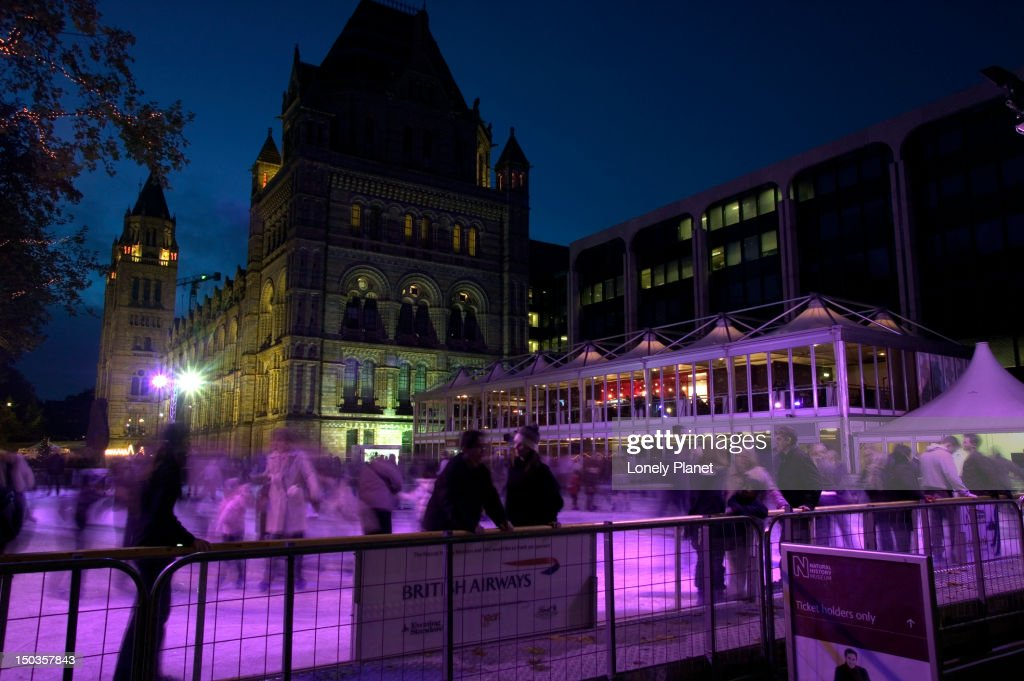 Ice skaters outside Natural History Museum. : Stock Photo