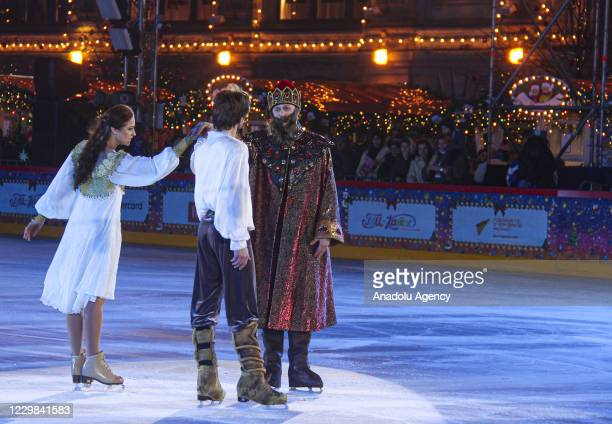 """Ice skaters perform during the opening of ice skate season at """"GUM"""" ice skating rink in Red Square on November 28, 2020 in Moscow, Russia."""