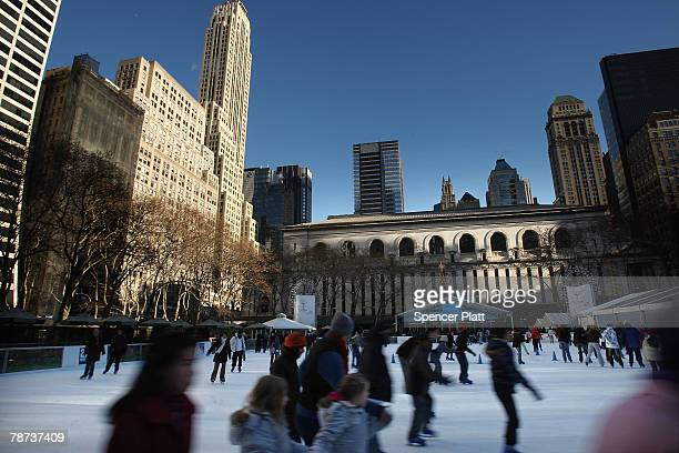 Ice skaters skate on the rink at Bryant Park January 3 2008 in New York City While much of the East Coast is experiencing freezing temperatures...