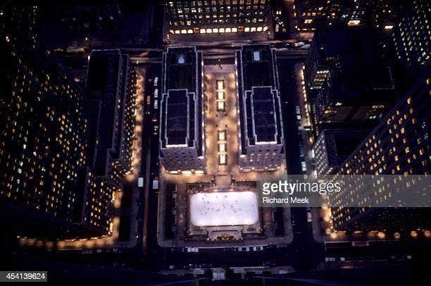 Aerial view of The Rink at Rockefeller Center shortly after dusk on a winter evening from the 51st floor of the RCA Building Fifth Avenue runs across...