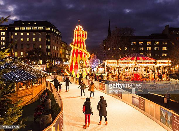 ice skating at christmas - ice rink stock photos and pictures
