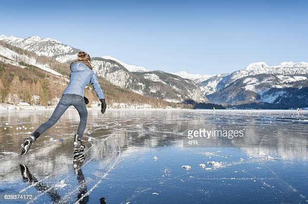 ice skating, frozen lake grundlsee, austria - wintersport stock-fotos und bilder