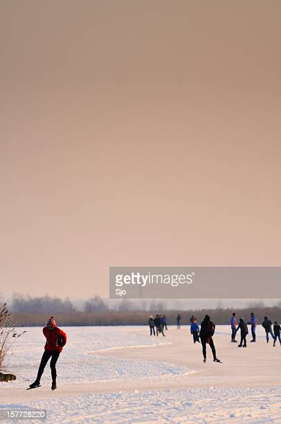 """ice skating in a sunset - """"sjoerd van der wal"""" or """"sjo"""" stock pictures, royalty-free photos & images"""