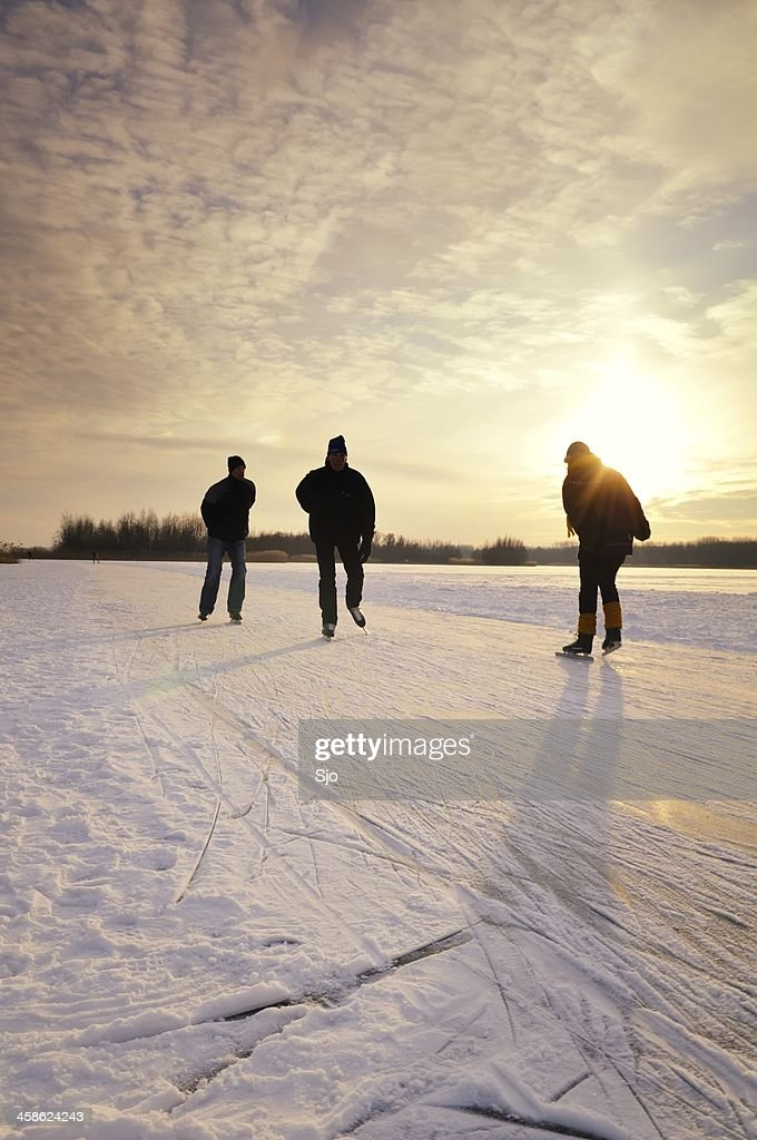 Ice skating in a sunset : Stock Photo