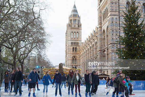 ice skating in front of natural history museum, london, uk - natural history museum london stock pictures, royalty-free photos & images