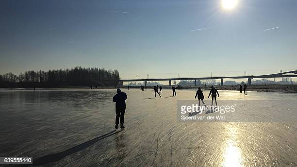 "ice skating on a frozen lake in holland during winter - ""sjoerd van der wal"" photos et images de collection"