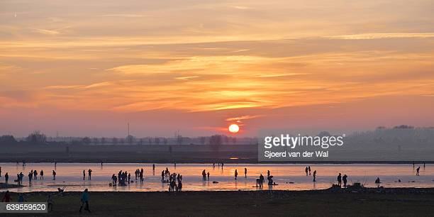 """ice skating on a frozen lake in holland during winter - """"sjoerd van der wal"""" stock pictures, royalty-free photos & images"""