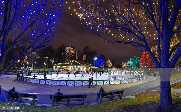 Ice skating on Boston Common during The Holidays, Boston, Massachusetts.