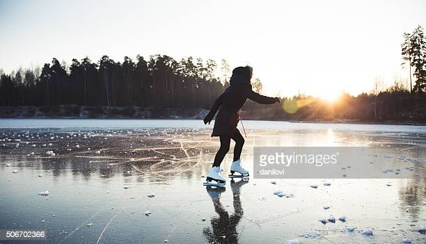 ice skating on the frozen lake - skating stock pictures, royalty-free photos & images
