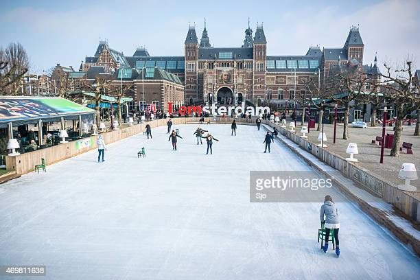 ice skating people in winter in amsterdam at the rijksmuseum - museumplein stock pictures, royalty-free photos & images