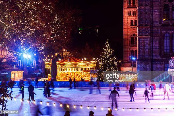 ice skating rink, natural history museum, london - natural history museum london stock pictures, royalty-free photos & images
