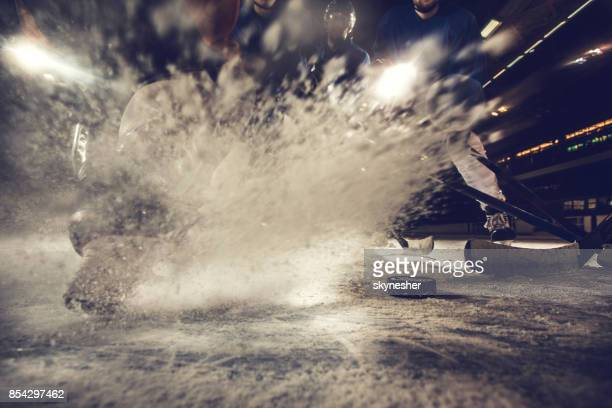 ice splashing on a hockey match in a rink! - ice hockey uniform stock pictures, royalty-free photos & images