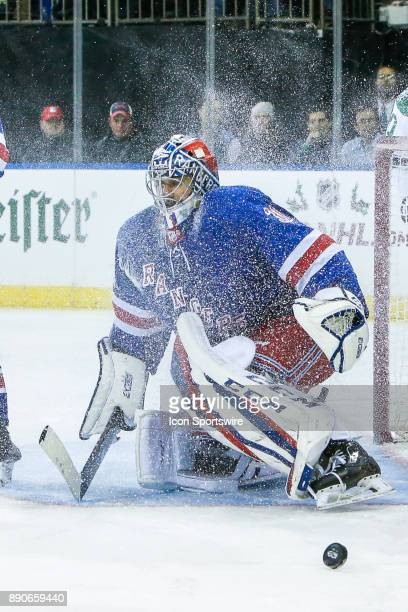 Ice sprays around New York Rangers Goalie Ondrej Pavelec after save during the Dallas Stars and New York Rangers NHL game on December 11 at Madison...