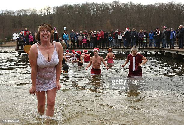 Ice swimmers leave the water after swimming in the Obersee in Lanke about 50 kilometers north of Berlin on December 22 2013 in Lanke Germany The...