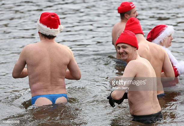 Ice swimmers wade in the Obersee in Lanke about 50 kilometers north of Berlin on December 22 2013 in Lanke Germany The swimmers who dress up in...