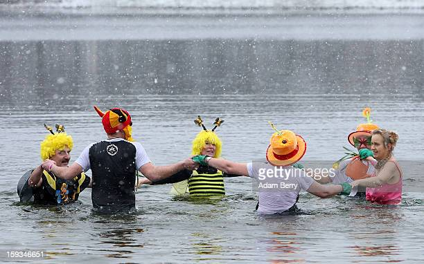 Ice swimming enthusiasts wade in the cold waters of Orankesee lake during the 'Winter Swimming in Berlin' event on January 12 2013 in Berlin Germany...