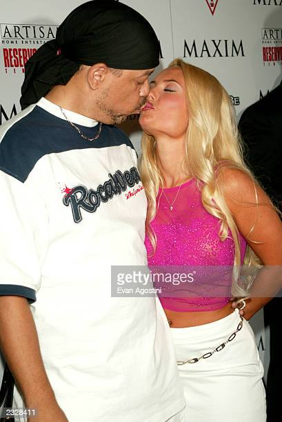 Ice T kissing his girlfriend Coco at the Reservoir Dogs 10th Anniversary DVD Release Party sponsored by Maxim and Artisan Home Entertainment at Trust...