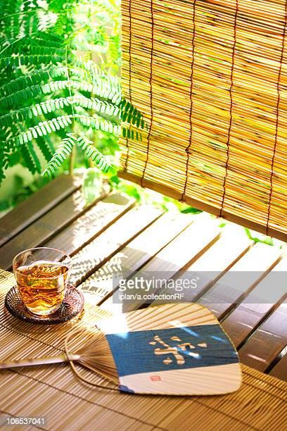 Ice tea and fan at veranda, Kanagawa Prefecture, Honshu, Japan