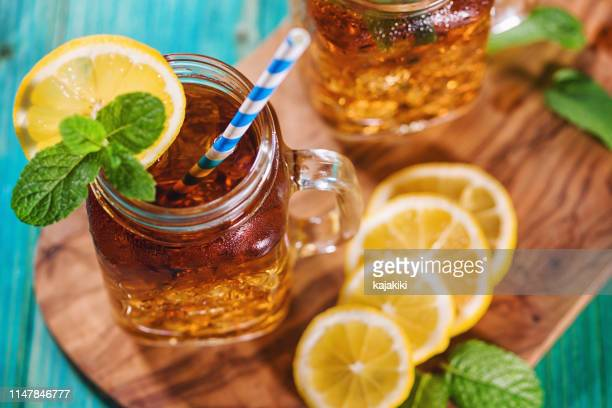ice tea with lemon and mint in a jar - tea stock pictures, royalty-free photos & images