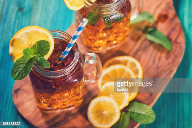 ice tea with lemon and mint in a jar - sweet food stock pictures, royalty-free photos & images