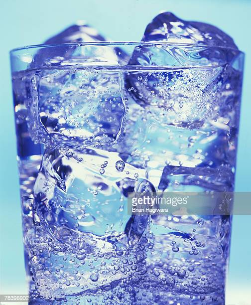 ice water - soda bottle stock photos and pictures
