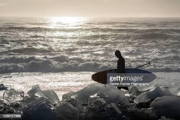 ice water surfer in iceland - north fotografías e imágenes de stock