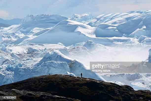 iceberg along fjord of ilulissat - ilulissat stock-fotos und bilder