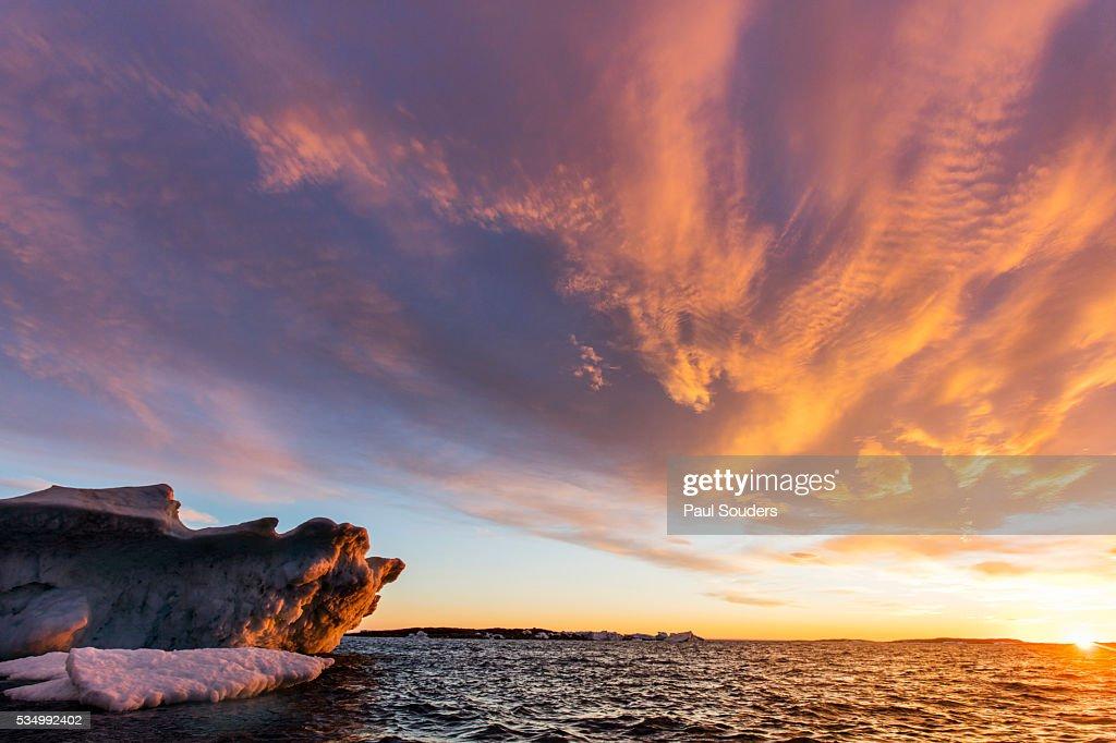 Iceberg and Midnight Sun in Repulse Bay, Nunavut, Canada : Stock Photo