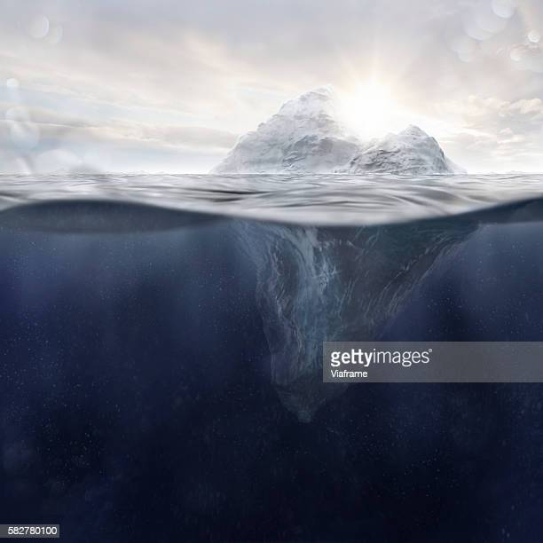Iceberg at sunset and water particles