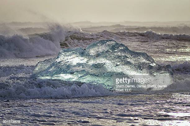 iceberg being tossed in the surf - damlo does stock pictures, royalty-free photos & images