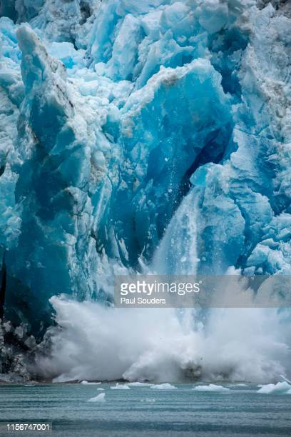 iceberg calving from south sawyer glacier, tracy arm, alaska - glacier collapsing stock pictures, royalty-free photos & images