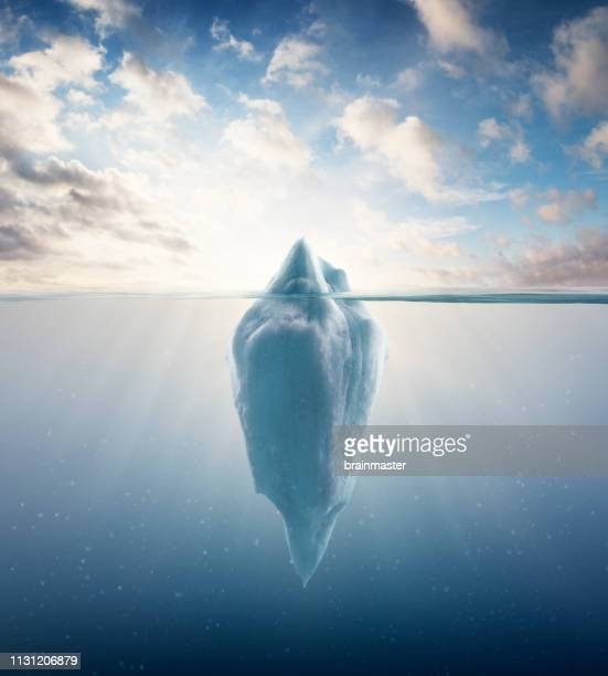 iceberg floating on sea - berg stock pictures, royalty-free photos & images