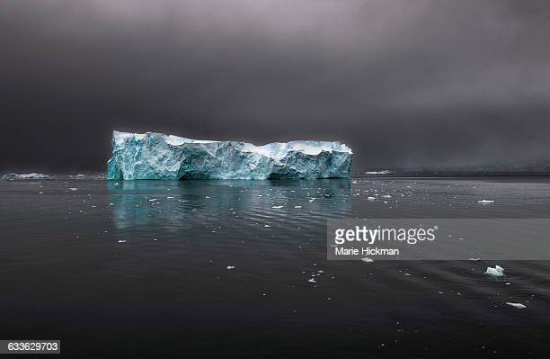 Iceberg in Antarctic with bits of floating ice
