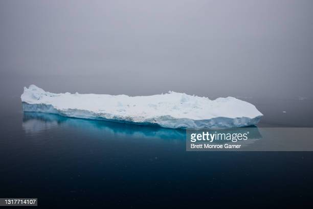 iceberg in antarctica - ice floe stock pictures, royalty-free photos & images