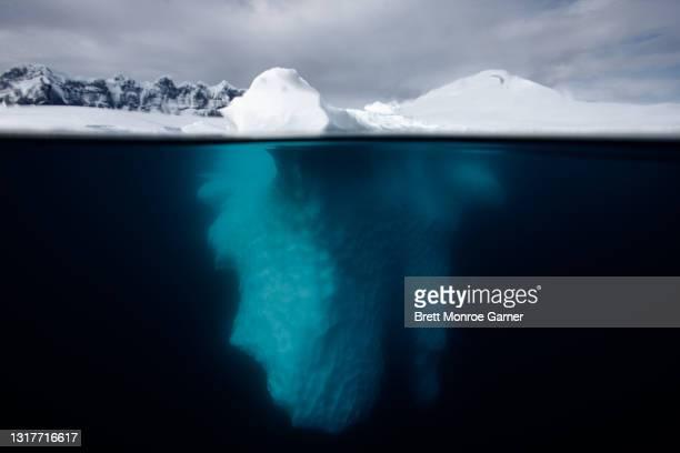 iceberg in antarctica underwater - antarctic sound stock pictures, royalty-free photos & images